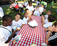 "Kids and Apples during a  D.C United clinic in support of first lady Michelle Obama's ""Let's Move"" initiative on the White House lawn, in Washington D.C. on October 7 2010."