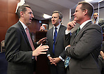 Nevada Sens. Scott Hammond, Greg Brower and Mark Hutchison talk on the Senate floor at the Legislative Building in Carson City, Nev., on Monday, March 11, 2013..Photo by Cathleen Allison