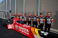 Sep 13, 2013; Charlotte, NC, USA; NHRA top fuel dragster driver Antron Brown and crew poses for a portrait prior to qualifying for the Carolina Nationals at zMax Dragway. Mandatory Credit: Mark J. Rebilas-