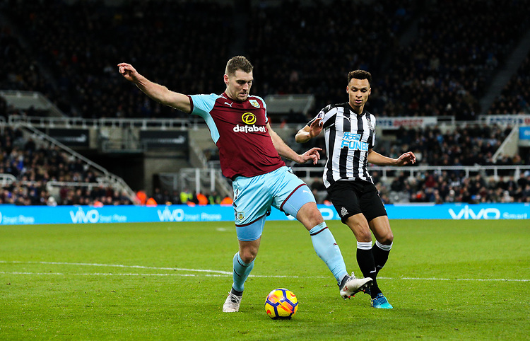 Burnley's Sam Vokes shields the ball from Newcastle United's Jacob Murphy<br /> <br /> Photographer Alex Dodd/CameraSport<br /> <br /> The Premier League - Newcastle United v Burnley - Wednesday 31st January 2018 - St James' Park - Newcastle<br /> <br /> World Copyright &copy; 2018 CameraSport. All rights reserved. 43 Linden Ave. Countesthorpe. Leicester. England. LE8 5PG - Tel: +44 (0) 116 277 4147 - admin@camerasport.com - www.camerasport.com