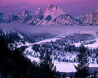 Foggy sunrise glow at the Snake River Overlook; Grand Teton National Park, WY