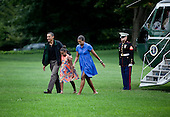 United States President Barack Obama (L), first lady Michelle Obama (R) and their daughter Sasha walk from Marine One on the South Lawn of the White House, Sunday, August 15, 2010 in Washington, DC.  President Obama was returning from the Gulf Coast where he stayed in Panama City Beach, Florida with first lady Michelle Obama and their daughter Sasha for an overnight trip to the region which has been affected by the BP oil spill from the sinking of the Deep Water Horizon drilling platform. .Credit: Brendan Smialowski - Pool via CNP