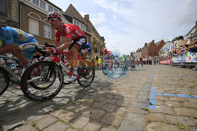The peleton including Lars Ytting Bak (DEN) Lotto-Belisol pass through the ancient town of Cassel during Stage 4 of the 2014 Tour de France running 163.5km from Le Touquet to Lille. 8th July 2014.<br /> Picture: Eoin Clarke www.newsfile.ie
