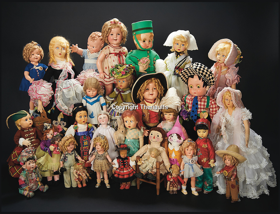 BNPS.co.uk (01202 558833)<br /> Pic: Theriaults/BNPS<br /> <br /> A collection of Shirley Temple's dolls.<br /> <br /> The costumes worn by childhood movie star Shirley Temple during her Hollywood career make up a long-lost £1.5m collection belonging to the late actress.<br /> <br /> The curly-haired performer's parents made it a condition that she got to keep all of her outfits after filming rather than return them to the movie studios.<br /> <br /> The child costumes, that include the iconic red and white polka-dot dress the then six year old wore in her breakthrough role in the 1934 flick 'Stand Up and Cheer', have been locked away in a vault at her home for 75 years. They are being sold in Maryland, US.