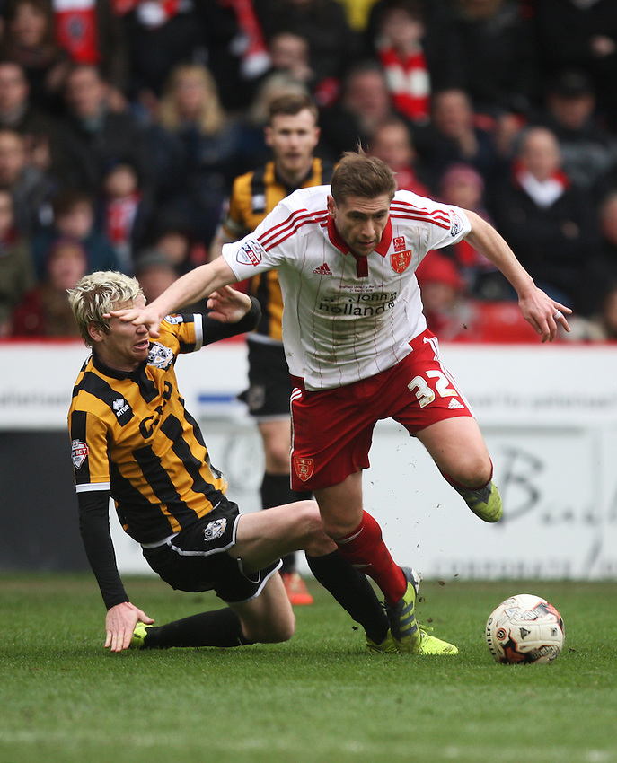 Port Vale's Ryan McGivern (L) fouls Sheffield United's Steven Davies <br /> <br /> Photographer Jack Phillips/CameraSport<br /> <br /> Football - The Football League Sky Bet League One - Sheffield United v Port Vale - Saturday 21st March 2015 - Bramall Lane - Sheffield<br /> <br /> &copy; CameraSport - 43 Linden Ave. Countesthorpe. Leicester. England. LE8 5PG - Tel: +44 (0) 116 277 4147 - admin@camerasport.com - www.camerasport.com