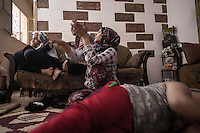 June 09, 2015 - Beirut, Lebanon: Hannan (centre), two of her children (Muhammed Ali/right and daughter/no name/left) and her friend Ammal Akkar (centre bottom), Palestinian refugees are seen inside their house in Shatila refugee camp. (Photo/Narciso Contreras)