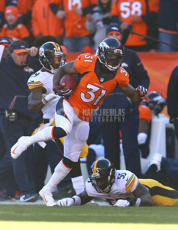 Jan 17, 2016; Denver, CO, USA; Denver Broncos safety Omar Bolden (31) returns a kickoff against the Pittsburgh Steelers during the AFC Divisional round playoff game at Sports Authority Field at Mile High. Mandatory Credit: Mark J. Rebilas-USA TODAY Sports