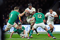 Maro Itoje of England takes on the Ireland defence. RBS Six Nations match between England and Ireland on February 27, 2016 at Twickenham Stadium in London, England. Photo by: Patrick Khachfe / Onside Images