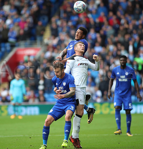 30th September 2017, Cardiff City Stadium, Cardiff, Wales; EFL Championship football, Cardiff City versus Derby County; Nathaniel Mendez-Laing of Cardiff City gets up over Sam Winnall of Derby County to win the header