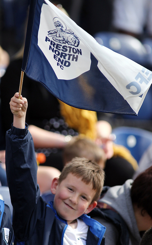 A Preston North End fan waves his team flag before kick-off<br /> <br /> Photo by Rich Linley/CameraSport<br /> <br /> Football - The Football League Sky Bet League One - Preston v Gillingham - Saturday 26th April 2014 - Deepdale - Preston<br /> <br /> &copy; CameraSport - 43 Linden Ave. Countesthorpe. Leicester. England. LE8 5PG - Tel: +44 (0) 116 277 4147 - admin@camerasport.com - www.camerasport.com