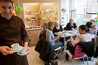 Chocolatier Patrice Arbona serves coffee and chocolate to customers at his shop 'Entre Mes Chocolats', Vence, France, 10 February 2011
