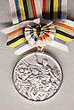 JULY 26, 2011 -  Silver medal for Tokyo Olympics : History of the Olympics in Japan at Japan Mint in Osaka, Japan. (Photo by AFLO) [1080]