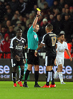 Danny Simpson of Leicester City sees a yellow card by match referee Michael Oliver during the Barclays Premier League match between Swansea City and Leicester City at the Liberty Stadium, Swansea on December 05 2015