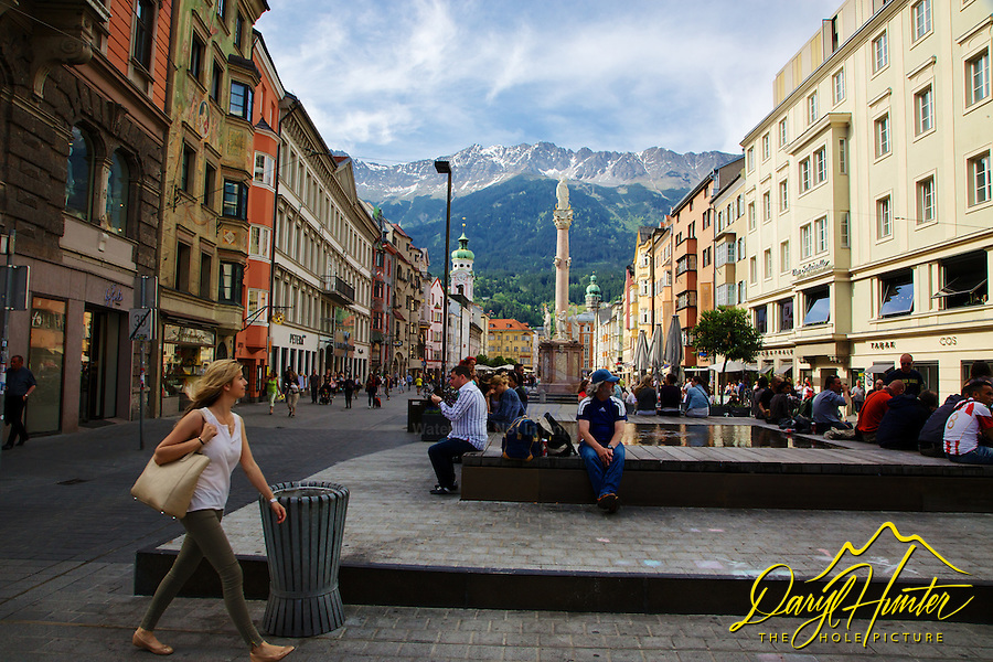 Woman walking, old town,  Nordkette Mountain, Innsbruck Austria,