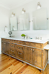White marble counters complement the warm wood of the vanity in this bathroom. This image is available through an alternate architectural stock image agency, Collinstock located here: http://www.collinstock.com