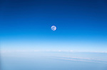Full moon in a blue sky.