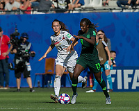 GRENOBLE, FRANCE - JUNE 22: Ngozi Okobi #13 of the Nigerian National Team dribbles as Sara Daebritz #13 of the German National Team defends during a game between Nigeria and Germany at Stade des Alpes on June 22, 2019 in Grenoble, France.