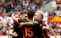 Calcio, Serie A: Roma vs ChievoVerona. Roma, stadio Olimpico, 8 maggio 2016.<br /> Roma's Miralem Pjanic celebrates with teammates Francesco Totti, left, and Radja Nainggolan, after scoring during the Italian Serie A football match between Roma and ChievoVerona at Rome's Olympic stadium, 8 May 2016.<br /> UPDATE IMAGES PRESS/Isabella Bonotto