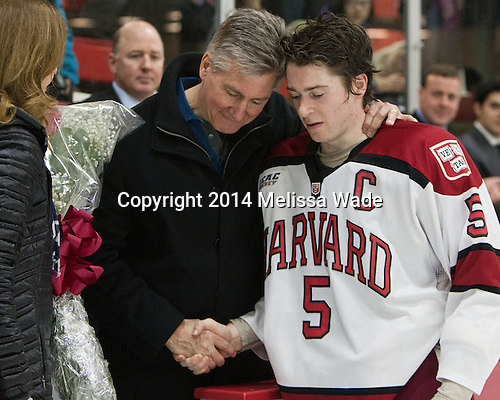 Dan Ford (Harvard - 5) and father. - The Harvard University Crimson honored their seniors following their final home game of the regular season on Saturday, February 22, 2014 at the Bright-Landry Hockey Center in Cambridge, Massachusetts.