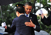 United States President Barack Obama hugs South Korean President Lee Myung-bak during an arrival ceremony on the South Lawn of the White House in Washington, D.C. on Thursday, October 13, 2011.  .Credit: Kevin Dietsch / Pool via CNP