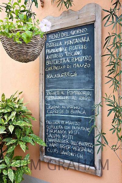 Chalkboard menu for restaurant Enoteca Baldi in Piazza Bucciarelli, Panzano-in-Chianti, Tuscany, Italy