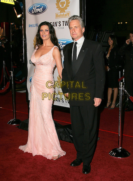 "CATHERINE ZETA-JONES & MICHAEL DOUGLAS.The Warner Brothers' World Premiere of ""Ocean's Twelve"" held at The Grauman's Chinese Theatre in Hollywood, California .December 8th,2 004.full length, celebrity couple, married, husband, black suit, light pink dress, jewel encrusted.www.capitalpictures.com.sales@capitalpictures.com.Supplied By Capital PIctures"