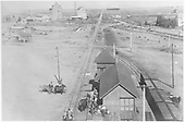 D&amp;RG depot activity at Monte Vista with several teams and people loading/unloading.  A section car with 4 members of the section gang is in front of the depot.<br /> D&amp;RG  Monte Vista, CO  ca. 1897