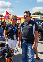 Sep 2, 2016; Clermont, IN, USA; Papa Johns pizza founder John Schnatter (right) and wife Annette Schnatter during NHRA qualifying for the US Nationals at Lucas Oil Raceway. Mandatory Credit: Mark J. Rebilas-USA TODAY Sports