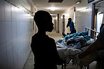 A young boy accompanies his father, who is sick with cholera, to receive an x-ray at the Hospital Albert Schweitzer on Friday, October 29, 2010 in Deschapelles, Haiti.