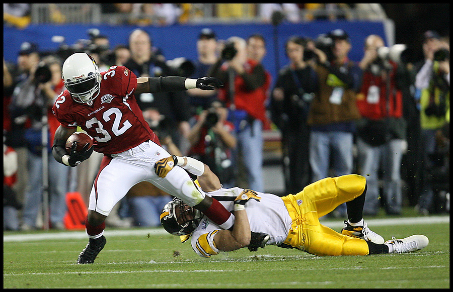 TAMPA, FL-.Pittsburgh Steelers linebacker James Farrior holds tight onto the leg of Arizona Cardinals running back Edgerrin James, left, during the second quarter of Super Bowl XLIII at Raymond James Stadium in Tampa on Sunday, February 1st, 2009..(Photo by Brian Blanco/Bradenton Herald)
