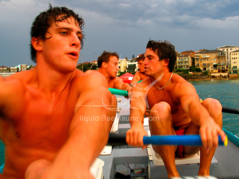 On board a surf boat from the North Bondi Surf Life Saving Club during a training session on Bondi Beach.