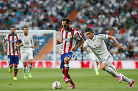 James of Real Madrid and Juanfran of Atletico de Madrid during La Liga match between Real Madrid and Atletico de Madrid at Santiago Bernabeu stadium in Madrid, Spain. September 13, 2014. (ALTERPHOTOS/Caro Marin)