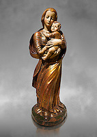 Gothic wooden statue of Madonna and Child by Seguidor de Diego de Siloe of Burgos, circa 1530-1540, tempera and gold leaf on wood, from the church of San Miguel de Medina del Campo, Valladolid..  National Museum of Catalan Art, Barcelona, Spain, inv no: MNAC  131050. Against a grey art background.