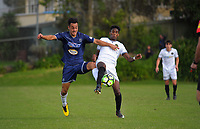 Auckland's Te Atawhai Hudson-Wihongi and Team Wellington's Nathanael Hailemariam compete for the ball during the 2018 OFC Champions League semifinal between Auckland City FC and Team Wellington at Kiwitea St in Auckland, New Zealand on Sunday, 29 April 2018. Photo: Dave Lintott / lintottphoto.co.nz