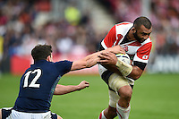 Michael Leitch of Japan looks to get past Matt Scott of Scotland. Rugby World Cup Pool B match between Scotland and Japan on September 23, 2015 at Kingsholm Stadium in Gloucester, England. Photo by: Patrick Khachfe / Stewart Communications