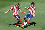 Atletico de Madrid's Jose Maria Gimenez (l) and Tiago Cardoso during La Liga match.September 14,2013. (ALTERPHOTOS/Acero)