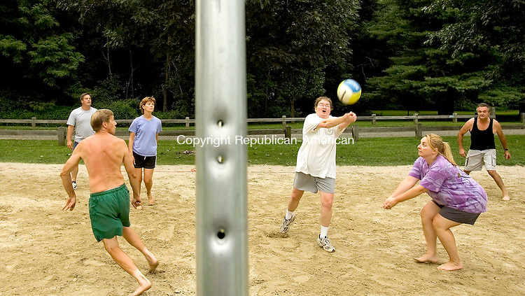 WOODBURY, CT-- 09  AUGUST 2007--080907JS02-Robin Griffin of Oxford, hits the ball while playing volleyball with, from left, Bill Ainsworth of Woodbury, MIke Hellwinkle of Woodbury, Debbie Holton of Woodbury, Elizabeth Sinkewicz of Naugatuck and Fred Raymond of Seymour, Thursday at Hollow Park in Woodbury. The volleyball league is part of the Woodbury Parks and Recreations activities for Monday and Thursday, but the group said they usually play everyday. <br /> Jim Shannon / Republican-American