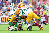 Landover, MD - September 23, 2018: Green Bay Packers quarterback Aaron Rodgers (12) is sacked by Washington Redskins defensive tackle Matthew Ioannidis (98) during game between the Green Bay Packers and the Washington Redskins at FedEx Field in Landover, MD. The Redskins get the win 31-17 over the visiting Packers. (Photo by Phillip Peters/Media Images International)