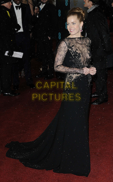 Amy Adams.EE British Academy Film Awards at The Royal Opera House, London, England 10th February 2013.BAFTA BAFTAS arrivals full length black dress lace side gold platform shoes .CAP/CAN.©Can Nguyen/Capital Pictures.