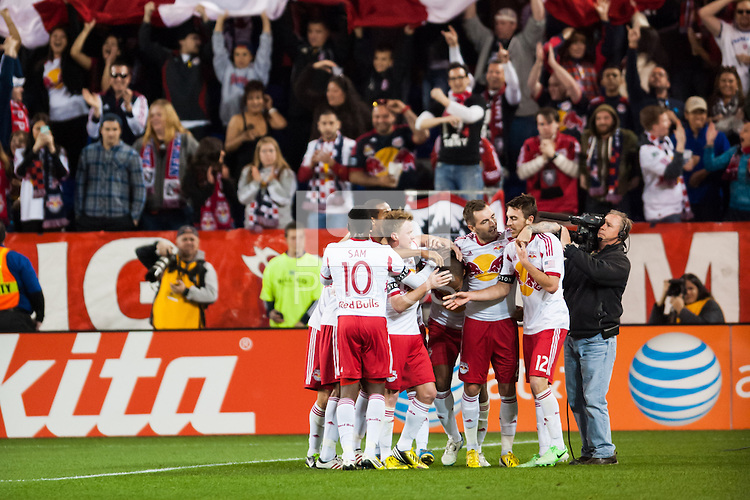 Jonny Steele (22) of the New York Red Bulls  celebrates scoring with teammates. The New York Red Bulls defeated the New England Revolution 4-1 during a Major League Soccer (MLS) match at Red Bull Arena in Harrison, NJ, on March 20, 2013.