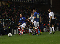 Dean Shiels (left) tackled watched by (left to right) Danny Carmichael, Lewis McLeod and Ryan McGuffie in the Rangers v Queen of the South Quarter Final match in the Ramsdens Cup played at Ibrox Stadium, Glasgow on 18.9.12.