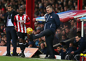 2nd December 2017, Griffen Park, Brentford, London; EFL Championship football, Brentford versus Fulham; Brentford Manager Dean Smith kicks the ball back to Josh Clarke of Brentford from the touchline