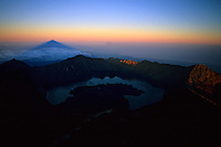 Gunung Rinjani casts its shadow across the Straits of Lombok, in the distance Gunung Agung and Bali, Indonesia, 2002