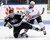 Tim Schaller (Providence - 11), Drew Ellement (NU - 2) - The Northeastern University Huskies defeated the Providence College Friars 3-1 (EN) on Tuesday, January 19, 2010, at Matthews Arena in Boston, Massachusetts.