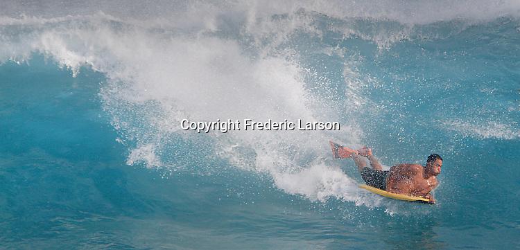 A boarder blows through a wave Sandy Beach in Hawaii during high-tide.