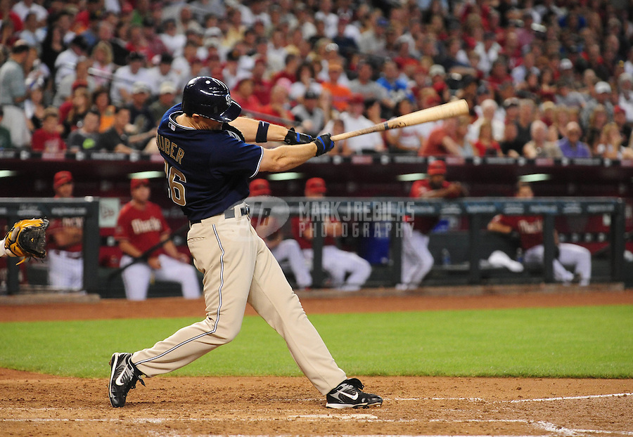 Apr. 20, 2008; Phoenix, AZ, USA; San Diego Padres left fielder Justin Huber hits a 3 run home run against the Arizona Diamondbacks at Chase Field. The home run was the first career homer for Huber. Mandatory Credit: Mark J. Rebilas-
