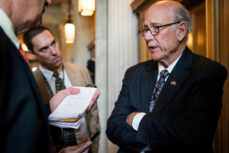 UNITED STATES - JUNE 11: Sen. Pat Roberts, R-Kan., speaks with reporters as he makes his to the weekly policy lunch in the Capitol on Tuesday, June 11, 2013.  (Photo By Bill Clark/CQ Roll Call)