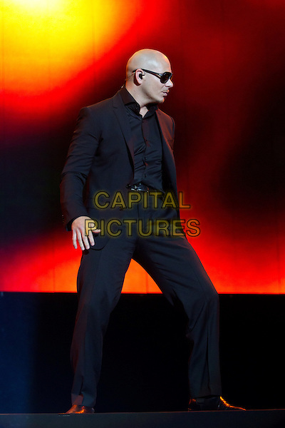 Pitbull (Armando Christian Perez).Concert in Krocus City Hall, Moscow, Russia..May 30th, 2012.on stage live gig performance performing music full length black suit sunglasses shades profile dancing .CAP/PER/SB.©SB/PersonaStars/CapitalPictures