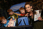 "All My Children's Alicia Minshew ""Kendall Hart Slater"" poses with ""Spike"" (Benjamin, Caleb, & Alex) as Alicia signs ""Kendall's"" new novel ""Charm"" for fans on February 20, 2008 at Barnes & Noble in Clifton, New Jersey. (Photo by Sue Coflin/Max Photos)"