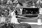 "Washington, D.C. - June 12, 1971 -- Tricia Nixon Cox and her husband, Edward Cox, walk down the aisle of the Rose Garden of the White House in Washington, D.C. on Saturday, June 12, 1971.  More than 400 guests attended the dazzling affair that was almost marred by rainfall..Credit: Benjamin E. ""Gene"" Forte / CNP"